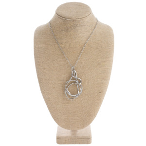 """Long metal abstract pendant necklace. Pendant approximately 3.5"""" in length. Approximately 36"""" in length overall."""