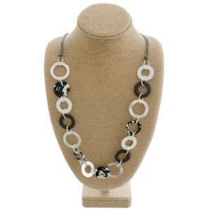 "Metal and resin disc linked faux leather cord statement necklace.   - Approximately 32"" in length with 3"" extender"