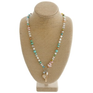 """Long semi precious beaded necklace featuring an inspirational charm pendant with """"Believe in Yourself"""" engraved details.  - Pendant approximately 2.25"""" in length - Approximately 34"""" in length overall"""