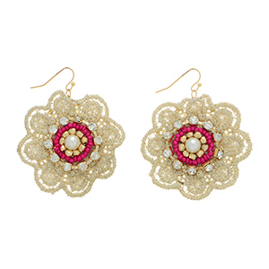 "2 3/8"" Gold tone fishhook style earrings featuring an ivory gold tone lace flower accented by fuchsia tone seed beads and crystal rhinestones."