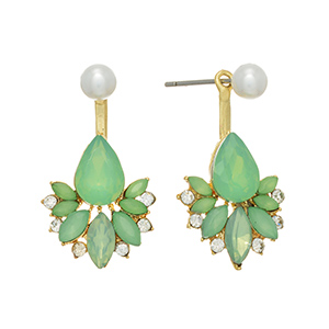 "Gold tone ear jacket earrings featuring a faux white pearl with mint green and clear rhinestone decor. Approximately 1 1/8"" in length."