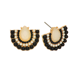 "Gold tone post earrings featuring an ivory teardrop shaped cabochon surrounded by black and ivory beads. Approximately 11/16"" in length."