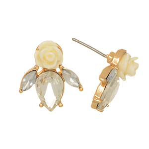 "Gold tone post earrings featuring an ivory rose with clear cabochons. Approximately 5/8"" in length."