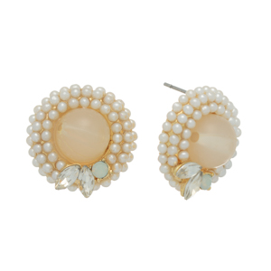 "Gold tone post earrings featuring a white bead surrounded by faux pearls with rhinestone accents. Approximately 3/4"" in length."