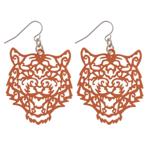 "Orange fishhook earrings featuring a cutout tiger. Approximately 1 1/2"" in length"