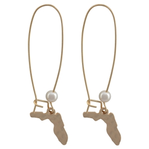 """Matte gold tone fishhook earrings with a hammered state of Florida and faux pearl accent. Approximately 1 3/4"""" in length."""