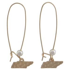 "Matte gold tone fishhook earrings with a hammered state of Tennessee and faux pearl accent. Approximately 1 3/4"" in length."