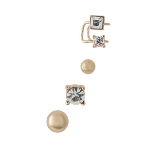 Gold tone three piece post style earrings with a matching rhinestone cuff earring.