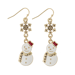 "Gold tone fishhook earrings displaying a snowflake charm with a dangling white snowman wearing a red hat. Charm approximately 1 1/2"" in length. Overall length 2""."
