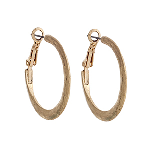 "Worn gold tone hammered hoop earrings. Approximately 1 3/16"" in length."