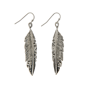 "Burnished silver tone fishhook earrings displaying a textured feather. Approximately 1 7/8"" in length."