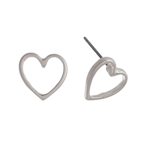 "Matte silver tone post style earrings displaying an open heart. Approximately 7/16"" in length."