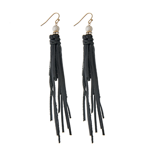 "Black leather tassel earrings with a pave ring and faux pearl accent. Approximately 4"" in length."