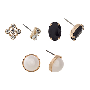 Gold tone set of three post style earrings displaying a rhinestone cluster, a black oval cabochon, and a round faux pearl.