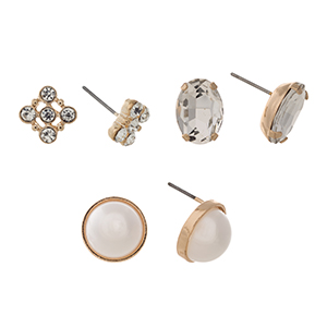 Gold tone set of three post style earrings displaying a rhinestone cluster, a clear oval cabochon, and a round faux pearl.