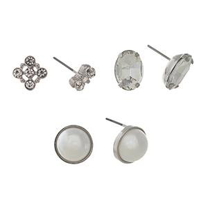 Silver tone set of three post style earrings displaying a rhinestone cluster, a clear oval cabochon, and a round faux pearl.