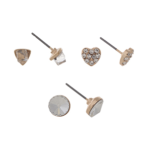 Gold tone set of three post style earrings displaying a clear cube, and pave heart, and a clear rhinestone stud.