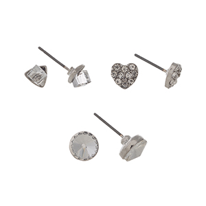 Silver tone set of three post style earrings displaying a clear cube, and pave heart, and a clear rhinestone stud.