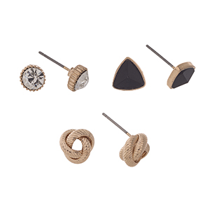 Gold tone set of three post style earrings displaying a rhinestone stud, a metal knot, and a black triangular stud.