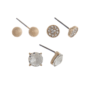 Gold tone set of three post style earrings displaying a textured ball, a pave disk, and a clear stud.