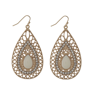 "Gold tone fishhook earrings displaying a teardrop shaped casting with an ivory cabochon and rhinestone accents. Approximately 2"" in length."