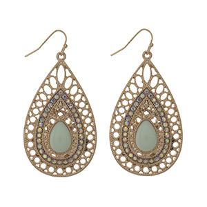 "Gold tone fishhook earrings displaying a teardrop shaped casting with a mint cabochon and rhinestone accents. Approximately 2"" in length."