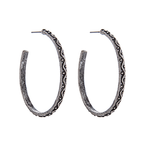 Burnished silver tone decorative hoop earrings. Approximately 1 3/4 in length.