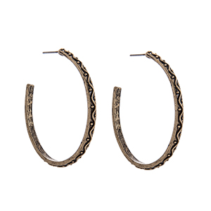 Burnished gold tone decorative hoop earrings. Approximately 1 3/4 in length.