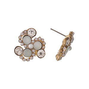 "Gold tone post style earrings displaying white and clear round rhinestones with faux pearl accents. Approximately 3/4"" in length."