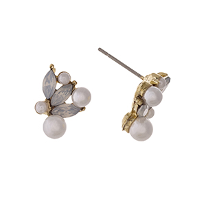 "Gold tone post style earrings displaying white pointed oval cabochons with faux pearl accents. Approximately 5/8"" in length."