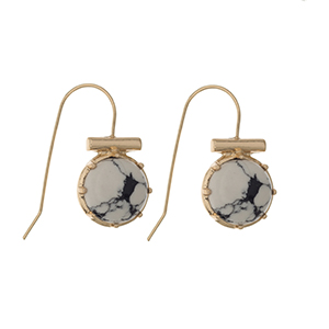 "Gold tone fishhook earrings displaying a white and black round stone. Approximately 3/8"" in length."