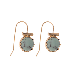 "Gold tone fishhook earrings displaying a turquoise round stone. Approximately 3/8"" in length."