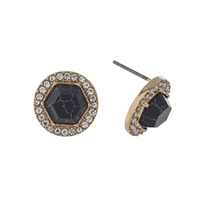 "Gold tone post style earrings displaying a black stone with a halo. Approximately 1/2"" in length."