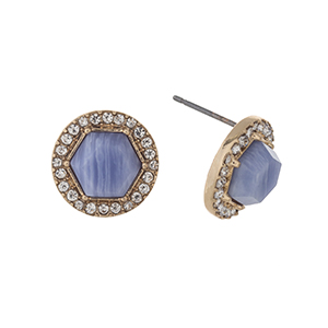 "Gold tone post style earrings displaying a blue stone with a halo. Approximately 1/2"" in length."
