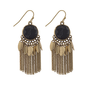 """Worn gold tone fishhook earrings displaying a round black stone with metal fringe. Approximately 1 3/4"""" in length."""