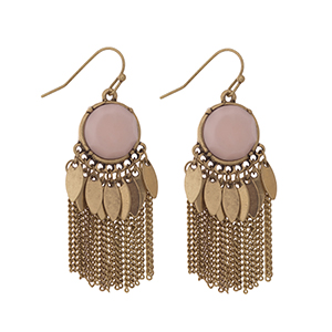 "Worn gold tone fishhook earrings displaying a round pink stone with metal fringe. Approximately 1 3/4"" in length."