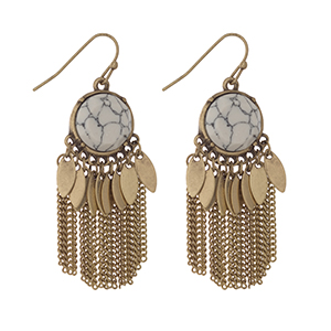 """Worn gold tone fishhook earrings displaying a round white stone with metal fringe. Approximately 1 3/4"""" in length."""