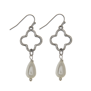 "Worn silver tone quatrefoil earrings with linked faux pearl teardrop. Approximately 1 1/2"" in length."