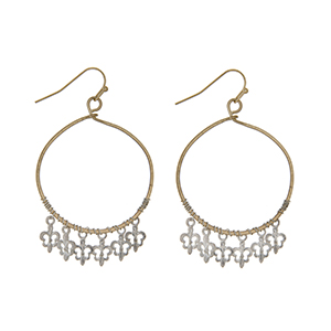 """Worn gold tone loop earrings with worn silver tone dangling fleur de lis charms. Approximately 1 5/8"""" in length."""