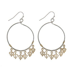 "Worn silver tone loop earrings with worn gold tone dangling fleur de lis charms. Approximately 1 5/8"" in length."