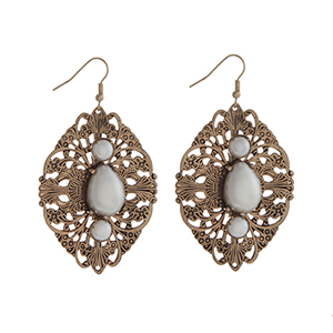 """Burnished gold tone fishhook earrings displaying a decorative casting with a teardrop and two round shape faux ivory pearls. Approximately 2 1/8"""" in length."""