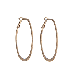 "Worn gold tone elongated hoop earrings. Approximately 2"" in length."