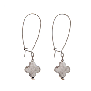 "Worn silver tone solid quatrefoil dangle earring. Approximately 2 1/8"" in length."