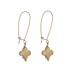 "Worn gold tone solid quatrefoil dangle earring. Approximately 2 1/8"" in length."