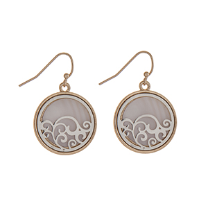 "Gold tone fishhook earrings displaying a white disk with a silver tone filigree design. Approximately 7/8"" in length."