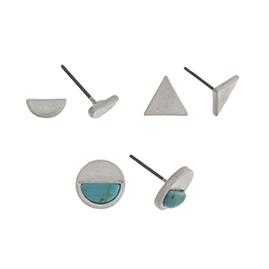 Matte silver tone set of three post style earrings displaying a semicircle, a triangle, and a disk with a turquoise stone.