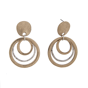 "Burnished gold tone post style earrings displaying two tone layered rings. Approximately 2 1/4"" in length."
