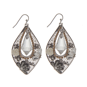 """Silver tone fishhook earrings displaying a teardrop shape casting with a clear stone surrounded by clear, black diamond, and topaz rhinestones and an ivory rose. Approximately 1 13/16"""" in length."""