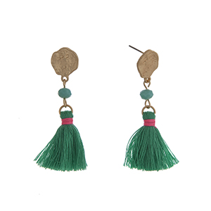 "Matte gold tone drop earrings displaying a turquoise bead with a linked green tassel. Approximately 2"" in length."
