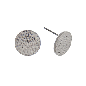 "Silver tone textured disk post style earrings. Approximately 3/8"" in length."
